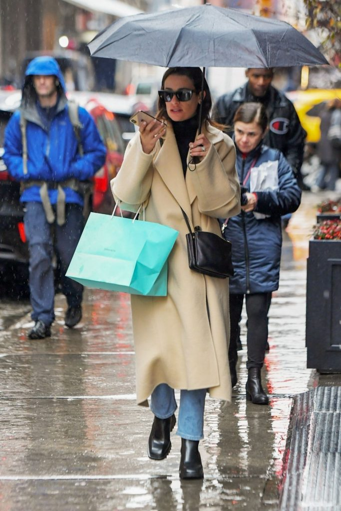 Lea Michele – Underneath Umbrella Out in New York