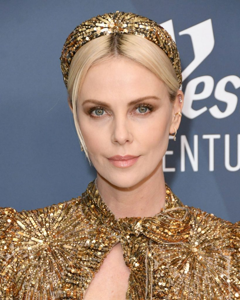 Charlize Theron – Costume Designers Guild Awards 2020 (12 Photos)
