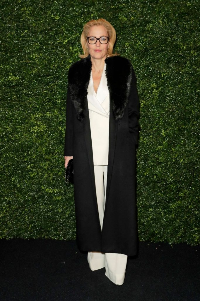 Gillian Anderson – Charles Finch and Chanel Pre-BAFTA Party 2020 (7 Photos)