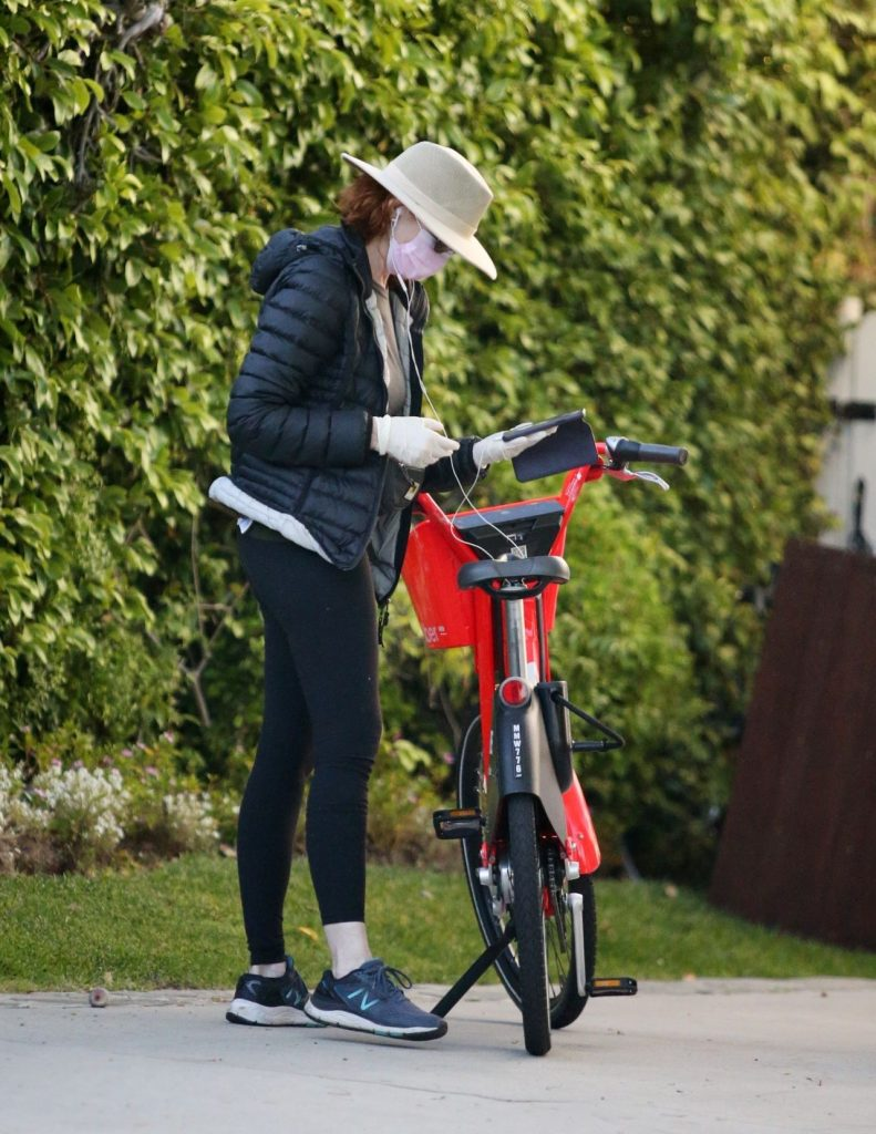 Marcia Cross – Bike Ride With a Mask and Gloves 2020 (10 Photos)