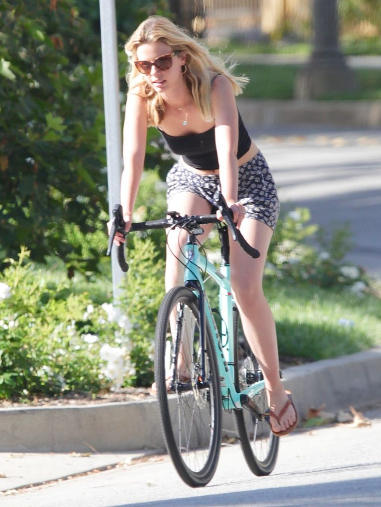 Mia Goth – Riding Her Bike in Los Angeles 2020 (4 Photos)