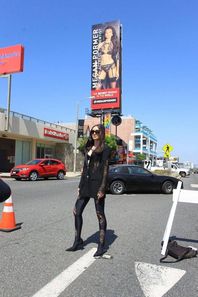 Megan Pormer – Posing in Front of Her Billboard on Sunset in Hollywood 2020